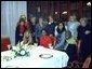 National Security Advisor Condoleeza Rice takes a group photo at the Karamah Iftaar Dinner.