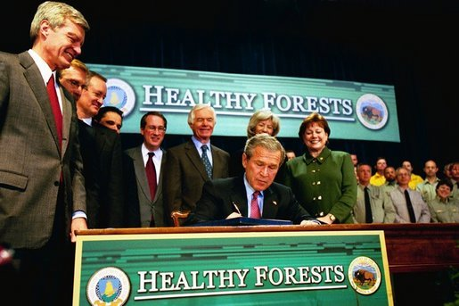 President George W. Bush signs the Healthy Forests Restoration Act of 2003 at the Department of Agriculture Wednesday, December 3, 2003. White House photo by Tina Hager.