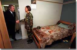 President George W. Bush visits a soldier in her barracks at Ft. Stewart, Georgia on February 12, 2001. President Bush visited several military bases last week to reaffirm his commitment to improve living conditions for the people who serve in America's armed forces. (WHITE HOUSE PHOTO BY PAUL MORSE)