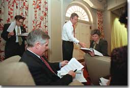 President George W. Bush holds meetings with advisors to discuss the budget plan.