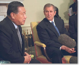 President Bush listens to Prime Minister Yoshiro Mori during a meeting in the Oval Office.