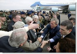 President George W. Bush greets military personnel at Charleston Air Force Base before departing Charleston, S.C., Feb. 5, 2004.   White House photo by Paul Morse