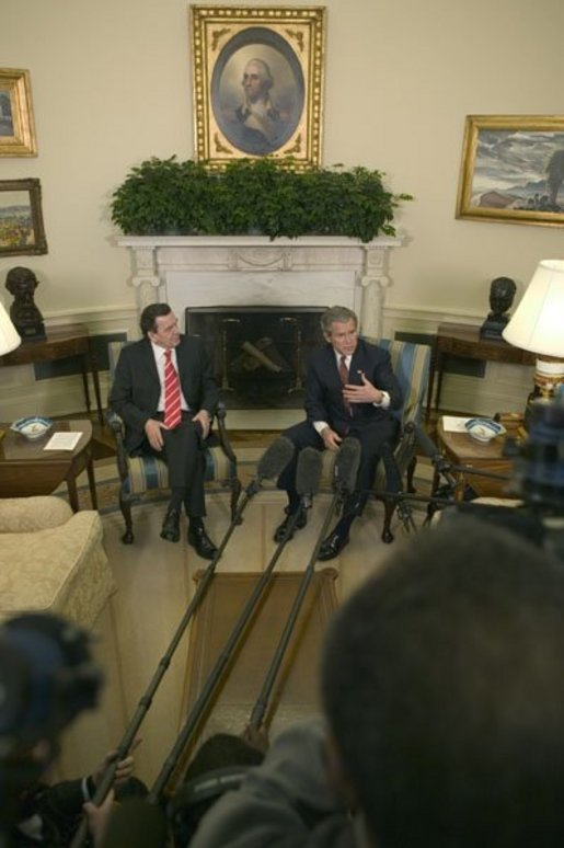 President George W. Bush and German Chancellor Gerhard Schroeder hold a joint press conference in the Oval Office Friday, Feb. 27, 2004. White House photo by Eric Draper