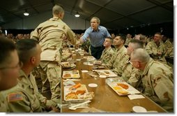 President George W. Bush greets national guardsmen as he joins them for lunch at Fort Polk, La., Tuesday, Feb. 17, 2004.  White House photo by Paul Morse