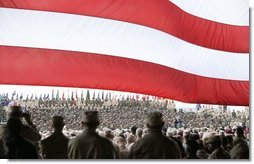 """President George W. Bush addresses military personnel at Fort Polk, La., Tuesday, Feb. 17, 2004. """"Since our nation was attacked on September the 11th, 2001, this post has trained and deployed more than 10,000 troops to fight the terrorist enemy,"""" said President Bush.  White House photo by Paul Morse"""