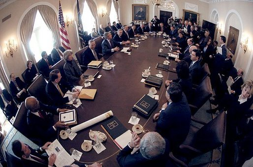 Seen through a fish-eye lens, President George W. Bush talks with reporters during a Cabinet Meeting at the White House Monday, Feb. 2, 2004. White House photo by Eric Draper.