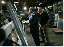 President George W. Bush participates in a tour of Nu-Air Manufacturing Company with employee Marshall Hartley in Tampa, Florida, Monday, Feb. 16, 2004.  White House photo by Eric Draper