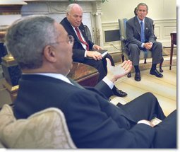 Secretary Colin Powell briefs President George W. Bush and Vice President Dick Cheney in the Oval Office, Thursday, Sept 19, on the progress of working with the United Nations, to convince the United Nations Security Council to deal with a threat to world peace. White House photo by Eric Draper.