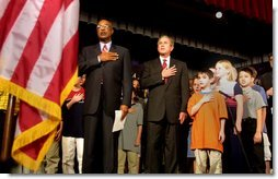 President George W. Bush pledges allegiance to the flag with Secretary of Education Rod Paige at a Pledge Across America event at East Literate Magnet School in Nashville, Tennessee on Tuesday, Sept. 17, 2002. White House photo by Paul Morse.