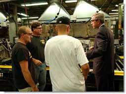 President George W. Bush tours the Sears Manufacturing Company in Davenport , Iowa on Monday, September 16, 2002. White House photo by Tina Hager.