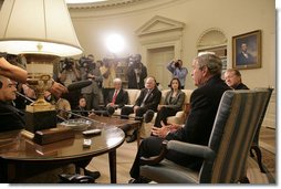 """President George W. Bush addresses the media during a meeting with business leaders on Lebanon Private Sector Initiative in the Oval Office Monday, Sept. 25, 2006. Seated next to President Bush is CEO John Chambers of Cisco Systems. Participants also include Chairman Craig Barrett of Intel Corp., CEO Ray Irani of Occidental Petroleum Corp., and Chairman Yousif Ghafari of Ghafari, Inc. """"Our goal, and our mission, is to help Lebanese citizens and Lebanese businesses not only recover, but to flourish, because we believe strongly in the concept of a democracy in Lebanon,"""" said President Bush.  White House photo by Eric Draper"""