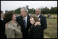 President George W. Bush embraces family members of those killed aboard United Flight 93 during the ceremony Monday, Sept. 11, 2006 in Shanksville, Pa., commemorating the fifth anniversary of the attacks on Sept. 11, 2001. White House photo by Eric Draper