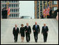 President George W. Bush and Laura Bush walk with New York City Mayor Michael Bloomberg, far left, New York Governor George Pataki, second from right, and former New York City Mayor Rudolph Giuliani down the entrance ramp to Ground Zero at the World Trade Center site in New York City Sunday, Sept. 10, 2006. White House photo by Kimberlee Hewitt