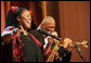 """Jazz vocalist Lisa Henry and saxophonist Bobby Watson perform their version of """"Kansas City"""" during the Thelonious Monk Institute of Jazz dinner Thursday night, Sept. 14, 2006, in the East Room of the White House. White House photo by Shealah Craighead"""