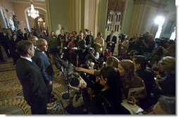 President George W. Bush stands with Senators Bill Frist, pictured in the foreground, and Mitch McConnell as he addresses the press after meeting with the Republican Senate Conference at the U. S. Capitol Thursday, Sept. 28, 2006.  White House photo by Eric Draper