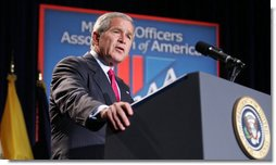 """President George W. Bush addresses his remarks on the global war on terror to members and guests at the Military Officers Association of America meeting Tuesday, Sept. 5, 2006, at the Capital Hilton Hotel in Washington. President Bush spoke about the U.S. and our allies strategy for combating terrorism saying """"we're confronting them before they gain the capacity to inflict unspeakable damage on the world, and we're confronting their hateful ideology before it fully takes root."""" White House photo by Kimberlee Hewitt"""