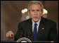 """President George W. Bush offers remarks Tuesday, Sept. 26, 2006, during a joint press availability in the East Room with President Hamid Karzai, of the Islamic Republic of Afghanistan. Said the President, """"The fighting in Afghanistan is part of a global struggle. Every victory in the war on terror enhances the security of free peoples everywhere."""" White House photo by Paul Morse"""