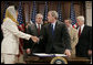 President George W. Bush shakes the hand of Ambassador Hunaina bint Sultan Al-Mughairy, of the Sultanate Oman to the United States, after signing H.R. 5684, the United States-Oman Free Trade Agreement Implementation Act Tuesday, Sept. 26, 2006, in the Dwight D. Eisenhower Executive Office Building. White House photo by Kimberlee Hewitt