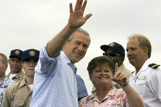 President George W. Bush waves as student Dorothy James points out other students at the Paul Hall Center for Maritime Training and Education in Piney Point, Md. Monday, September 4, 2006. White House photo by Kimberlee Hewitt