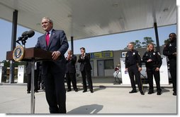 President George W. Bush talks about energy issues and the importance of developing and using alternative fuels Thursday, Sept. 28, 2006, during a visit to the Hoover Public Safety Center in Hoover, Ala. The city has just opened an alternative fueling station to provide E85 (ethanol) and biodiesel fuels for public agency vehicles. White House photo by Paul Morse