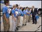 President George W. Bush congratulates members of the Columbus Northern Little League Team on winning the 2006 Little League Baseball World Series Championship at Dobbins Air Reserve Base in Marietta, Ga., Thursday, Sept. 7, 2006. White House photo by Eric Draper