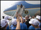 President George W. Bush waves to Georgia Governor Sonny Perdue and the Columbus Northern Little League Team at Dobbins Air Reserve Base in Marietta, Ga., Thursday, Sept. 7, 2006. The team defeated the Kawaguchi Little League of Japan, 2 to 1, to win the 2006 Little League Baseball World Series Championship on August 28 in Williamsport, Pa. It is the second consecutive year that an American team has won the world series title. White House photo by Eric Draper