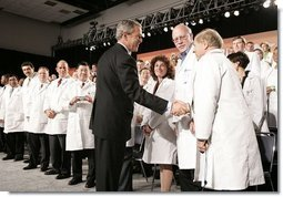 President George W. Bush greets physicians after discussing medical liability reform during a visit to Collinsville, Ill., Wednesday, Jan. 5, 2005.  White House photo by Paul Morse