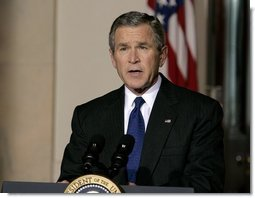 President George W. Bush delivers a live televised statement on Iraq's elections from the Cross Hall of the White House, Sunday, Jan. 30, 2005.  White House photo by Eric Draper