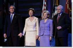 "President George W. Bush stands with Laura Bush, Lynne Cheney and Vice President Dick Cheney during the pre-inaugural event ""Saluting Those Who Serve"" at the MCI Center in Washington, D.C., Tuesday Jan. 18, 2005.  White House photo by Eric Draper"