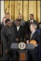 During a ceremony honoring the Detroit Pistons for winning the 2004 NBA Championship, President George W. Bush shares a laugh with basketball player Ben Wallace in the East Room, Jan. 31, 2005. White House photo by Paul Morse.