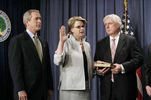 With President George W. Bush and her husband Robert Spellings by her side, Secretary of Education Margaret Spellings takes the oath of office during a ceremony at the Department of Education in Washington, D.C., Monday, Jan. 31, 2005. Secretary Spellings served as an Assistant to the President for Domestic Policy during the first term of the Bush administration. White House photo by Paul Morse.