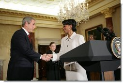 President Bush shakes hands with Dr. Condoleezza Rice after introducing her those in attendence for her ceremonial swearing-in at the U.S. Department of State Friday, Jan. 28, 2005.  White House photo by Eric Draper