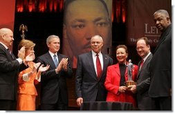 """Secretary of State Colin Powell and his wife Alma are accompanied by President George W. Bush and Mrs. Laura Bush while the Powell's received the John Thompson Legacy of a Dream Award from Georgetown University during the University's """"Let Freedom Ring"""" celebration honoring Dr. Martin Luther King, Jr. at the Kennedy Center for the Performing Arts on Monday, January 17, 2005.  White House photo by Paul Morse"""