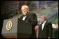 Vice President Dick Cheney introduces President George W. Bush at the Black Tie and Boots Inaugural Ball in Washington, D.C., Wednesday, Jan. 19, 2005. White House photo by David Bohrer