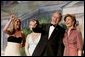With his twin daughters Jenna, left, and Barbara by his side, President George W. Bush points out members of the audience to Laura Bush during a Black Tie and Boots Inaugural Ball in Washington, D.C., Wednesday, Jan. 19, 2005. White House photo by Eric Draper