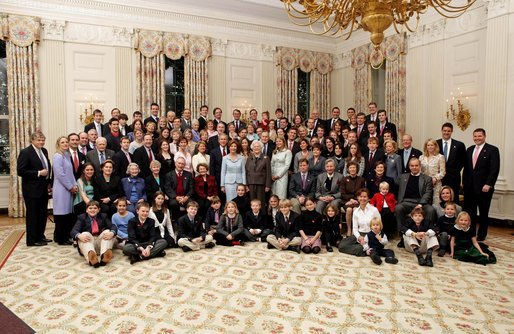 President George W. Bush, Laura Bush, former President George H. W. Bush, and former First Lady Barbara Bush pose for a portrait with members of their extended family in the East Room of the White House, Wednesday, Jan. 19, 2005. White House photo by Eric Draper