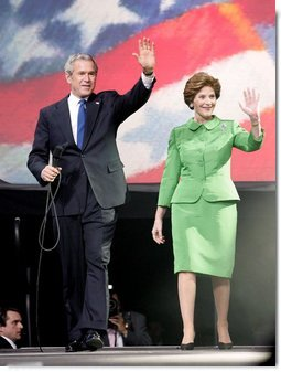 President George W. Bush and Laura Bush wave to young supporters during the pre-inaugural event 'America's Future Rocks Today- A Call to Service' youth event at the DC Armory in Washington, D.C., Tuesday, Jan. 18, 2005. The event highlighted the importance of volunteerism and community service in America's neighborhoods.  White House photo by Susan Sterner