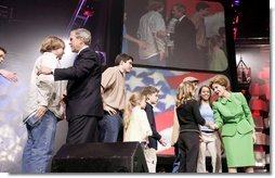 President George W. Bush and Laura Bush greet participants at the 'America's Future Rocks Today- A Call to Service' youth event at the DC Armory in Washington, D.C., Tuesday Jan. 18, 2005.  White House photo by Susan Sterner
