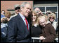 President George W. Bush poses for photos on his departure Tuesday, March 11, 2008 from Nashville, Tenn., following his address to the National Religious Broadcasters convention. White House photo by Chris Greenberg