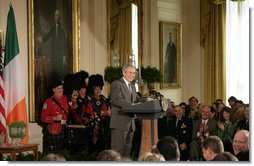 """President George W. Bush delivers remarks Monday, March 17, 2008, during a reception in celebration of St. Patrick's Day in the East Room of the White House. Speaking to the Prime Minister of Ireland, President Bush said, """"We've had a long relationship, Taoiseach. Our history has been one where the United States and Ireland have made liberty our common cause, and both of our nations are richer for it."""" White House photo by Shealah Craighead"""