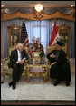 """Vice President Dick Cheney meets with the Chairman of the Supreme Council for the Islamic Revolution in Iraq Sayyed Abdul-Aziz al-Hakim Monday, March 17, 2008 at the Hakim residence in Baghdad. During a statement following their meeting the Vice President said, """"There is still a lot of difficult work that must be done, but as we move forward, the Iraqi people should know that they will have the unwavering support of President Bush and the United States in consolidating their democracy."""" White House photo by David Bohrer"""