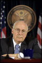 """Vice President Dick Cheney listens to a reporter's question Monday, March 17, 2008 during press availability with General David Petraeus and U.S. Ambassador to Iraq Ryan Crocker (not pictured) inside the Green Zone in Baghdad. """"This week marks the fifth anniversary since we launched into Iraq in March of '03,"""" said the Vice President during the press availability, adding, """"If you reflect back on those five years, I think it's been a difficult, challenging, but nonetheless successful endeavor; that we've come a long way in five years, and that it's been well worth the effort."""" White House photo by David Bohrer"""