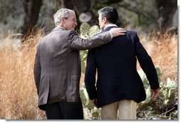 President George W. Bush and Prime Minister Anders Fogh Rasmussen of Denmark walk together at the conclusion of their press availability at The Bush Ranch in Crawford, Texas, Saturday, March 1, 2008, in Crawford, Texas. White House photo by Eric Draper