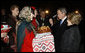 President George W. Bush acknowledges the taste of bread -- presented as a traditional Ukrainian welcome -- as he and Mrs. Laura Bush are greeted upon their arrival Monday, March 31, 2008, at Boryspil State International Airport in Kyiv. White House photo by Eric Draper