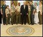 President George W. Bush welcomes Boy Scout representatives to the Oval Office Tuesday, March 4, 2008, as they presented him with their Report to the Nation, highlighting the 2007 accomplishments of the Boy Scouts of America. White House photo by Eric Draper