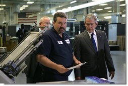 President George W. Bush talks with employees during his visit to ColorCraft of Virginia, Inc. Wednesday, March 26, 2008, in Sterling, Virginia. White House photo by Chris Greenberg
