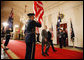 President George W. Bush and Australian Prime Minister pass an honor guard as the walk together through the Cross Hall Friday, March 28, 2008, after a joint press availability in the East Room of the White House. White House photo by Eric Draper