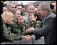 President George W. Bush shakes hands with troops following his event in Freehold, New Jersey Friday, March 28, 2008, at McGuire Air Force Base in New Jersey. White House photo by Chris Greenberg