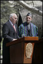 """With President Hamid Karzai of Afghanistan looking on, Vice President Dick Cheney delivers a statement to the press Thursday, March 20, 2008 on the grounds of Gul Khana Palace in Kabul. """"During the last six years, the people of Afghanistan have made a bold and confident journey, throwing off the burden of tyranny, winning your freedom and reclaiming your future,"""" said the Vice President, adding, """"The United States of America has proudly walked with you on this journey, and we walk with you still."""" White House photo by David Bohrer"""