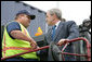 President George W. Bush shakes hands with Frederick Bishop, a stacker operator for Coastal Maritime Stevedoring, LLC, during a tour Tuesday, March 18, 2008, of the Blount Island Marine Terminal in Jacksonville, Fla. The President toured the facility while in the state to deliver remarks on trade policy. White House photo by Chris Greenberg